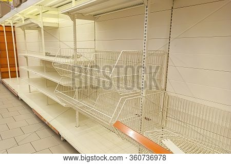 Empty Shelves In The Store. Sale Of Goods. Concept: Deficit, Epidemic, Pandemic. Demand For Goods.