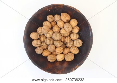 Walnuts Isolated On White Background. Heap Of Walnuts Isolated On White Background. Walnut In A Wood
