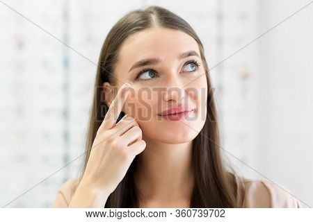 How To Apply Contact Lenses Concept. Close Up Portrait Of Young Woman Wearing Eye Lens, Looking Asid