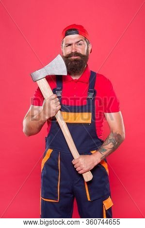 Man With Axe. Forester Hold The Ax. Man In Uniform Cut Beard Hair With Ax. Brutal Bearded Man Use Ax