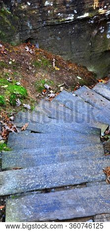 Narrow, Descending Wooden Steps Wind Down Through Narrow Rock Wall On The Way Down From Viewing The