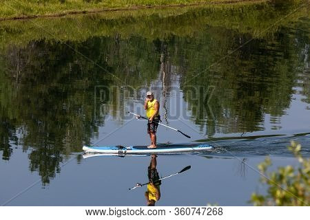Grand Teton National Park, Wyoming / Usa - July 17, 2014:  A Man Floating On A Paddle Board Down The