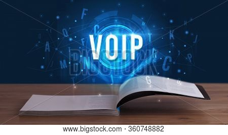 VOIP inscription coming out from an open book, digital technology concept