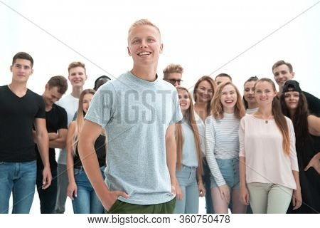 smiling leader standing in front of a casual group of young people