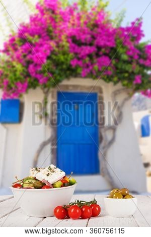 Greek food background. Traditional greek dishes with typical greek architecture