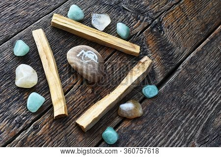 A Close Up Image Of Three Palo Santo Smudge Sticks With Green Aventurine And Citrine Healing Crystal