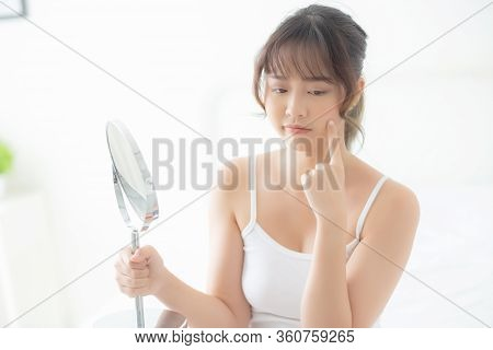 Beautiful Young Asian Woman Looking The Mirror With Acne Problem At Bedroom, Trouble Of Beauty On Fa