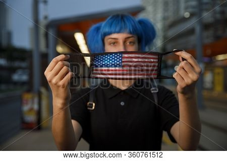 Young Female Using American Flag Medical Mask In City, Stylish Trendy Girl With Blue Hair And United