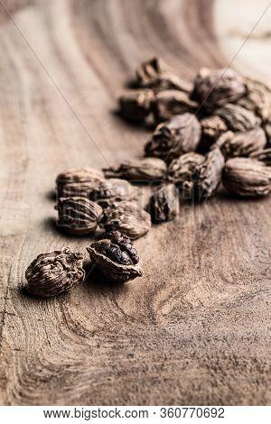 Black Cardamom On Wooden Background