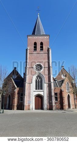 Kapellen, Belgium, April 2020: Front View On The Church Of The Village, St. Jacobuskerk, Which Lies