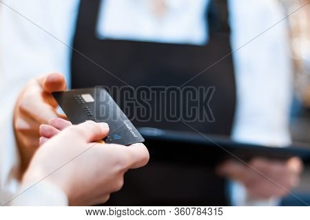 Closeup Woman Barista, Waiter In Brown Apron Uniform Is Holding Tablet Computer, Taking Credit Card