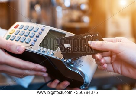 Closeup Of Female Hands Are Holding Terminal In Cafe, Restaurant, Shop. Seller, Waiter, Barista Is A