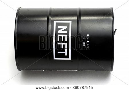 Black Iron Barrel With The Inscription Igniting Liquid Neft Lies On The White Background