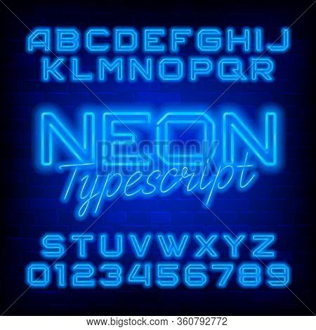 Neon Alphabet Font. Blue Neon Light Letters And Numbers. Dark Brick Wall Background. Stock Vector Ty