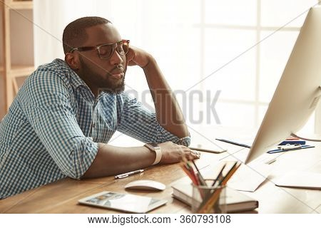 Sleeping At Working Place. Tired Young Afro American Man Feeling Tired And Sleeping While Sitting At