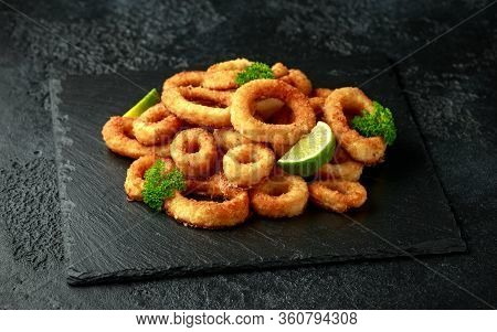 Oven Baked Breaded Calamari Rings Served With Lime Wedges, Sweet Chilli Sauce And Mayonnaise