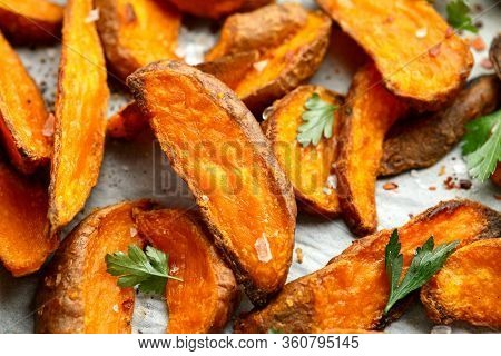 Healthy Baked Orange Sweet Potato Wedges With Dip Sauce, Herbs, Salt And Pepper.