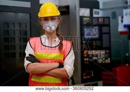 Pretty Technician Or Worker Woman With Gray Mask And Yellow Helmet Stand With Confident Action In Fr