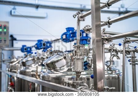 General View Of The Interior Of A Milk Factory. Equipment At Dairy Plant. Dairy Factory With Milk Pa