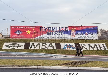 Belgrade, Serbia - December 25, 2014: People Passing By A Billboard Promoting Chinese Investments In