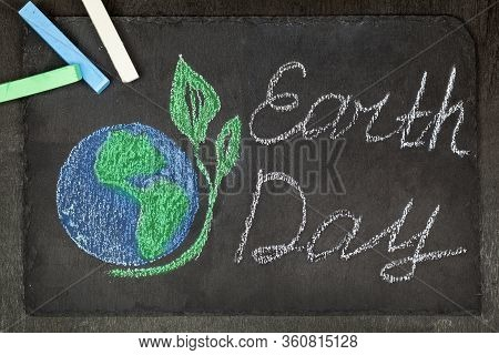 April 22, Chalk Drawing Planet Earth On A Black Background -earth Day.