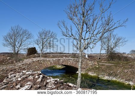 Small Creek With An Old Stone Bridge On The Swedish Island Oland