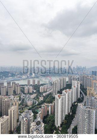 Aerial Drone Shot Of Caiyuanba Bridge Over Yangtze River And Dense Riverside Residential Building Al