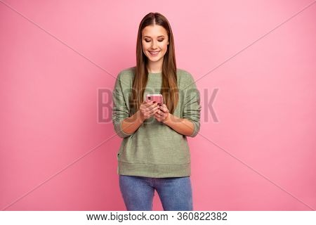 Portrait Of Positive Cheerful Girl Use Smartphone Read Social Network Novelty Wear Good Look Jumper