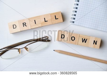 Modern Business Buzzword - Drill Down. Top View On Wooden Table With Blocks. Top View. Close Up.
