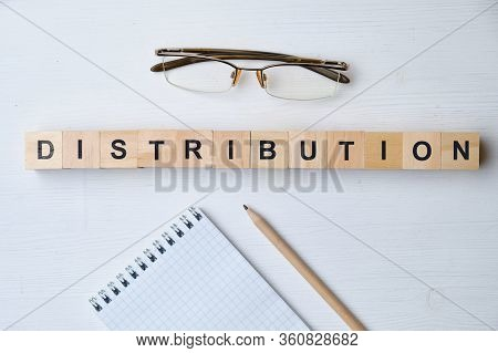 Modern Business Buzzword - Distribution. Top View On Wooden Table With Blocks. Top View. Close Up.