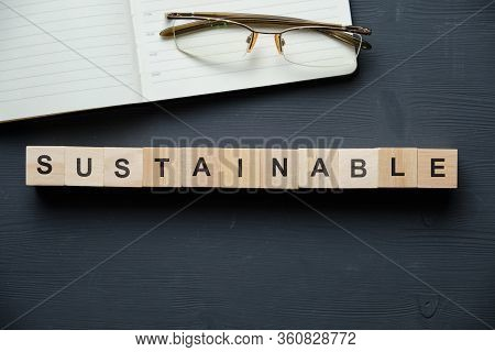 Modern Business Buzzword - Sustainable. Top View On Wooden Table With Blocks. Top View. Close Up.