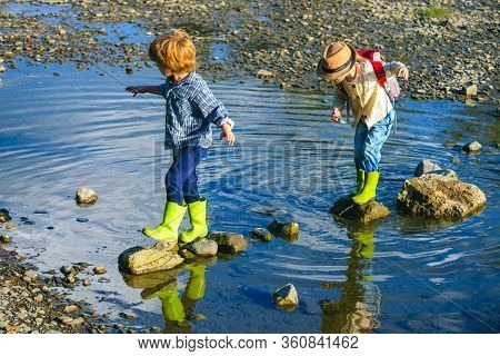 Happy Kids Enjoying On Beautiful River. Little Toddlers On Summer Day. Camping Fun. Little Tourists