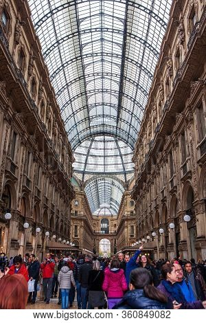 Milan, Italy - November 3, 2012:the Crowd Inside Of The Galleria Vittorio Emanuele Ii, The Oldest Ac