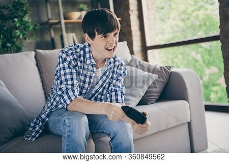 Photo Of Teenager School Boy Sit Comfy Couch Stay Home Quarantine Time Hold Joystick Playing Video G