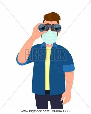 Young Hipster Man Wearing Medical Mask And Looking Through Binoculars. Trendy Person Covering Face P