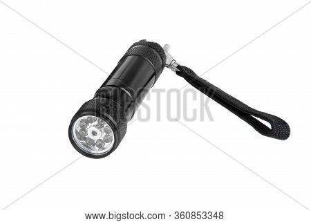 Flashlight Isolated On A White Background. Black Metal Flashlight, Torch, Battery-powered.