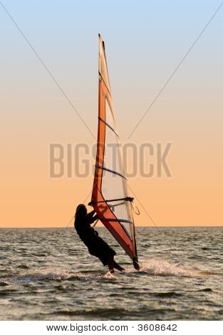 Silhouette Of A Windsurfer On A Gulf