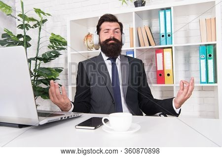 Manager With Headphones Listening Peaceful Melody. Meditation In Office. Relaxing And Calming Down.