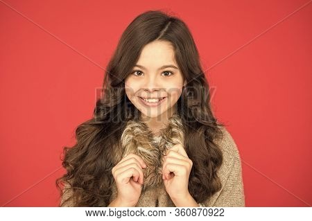 Girl Long Curly Hair. Little Beauty Smiling Red Background. Happy Childhood. Beautiful Model Kid. Fa