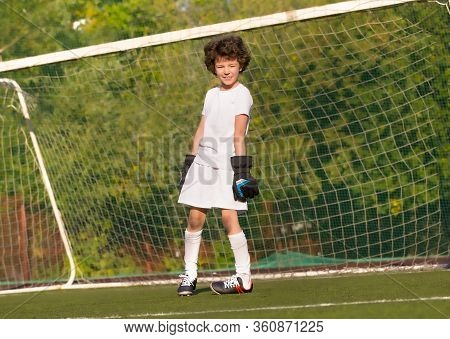 Summer Soccer Tournament For Young Kids. Football Club. Emotions And Joy Of The Game. Young Goalie.
