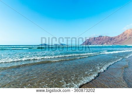 Panorama Of Beautiful Beach And Tropical Sea Of Lanzarote. Canaries. Coast Of Famara Beach, Lanzarot