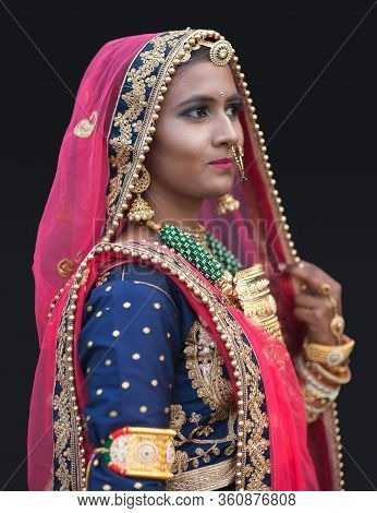 Bikaner, India - January 12, 2020: Indian Rajasthani Beautiful Girl In National Clothes Poses For A