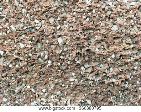 Concrete Wall With Small Stones. Background For Materials