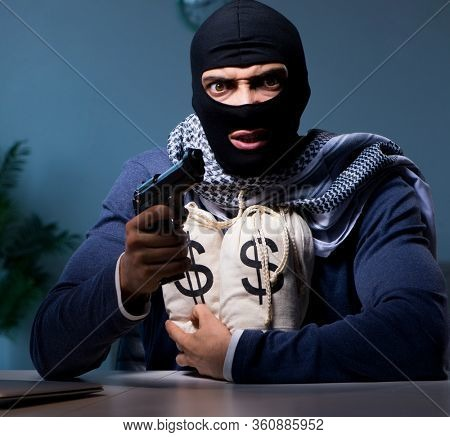 Terrorist burglar with gun asking for money ransom