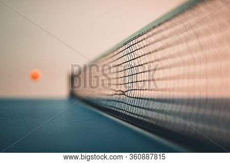 Ping Pong, Table Tennis With Ball Flying Over The Net. Motion Blur