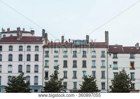 Traditional French Housing Buildings With 19th Century Facades On Place Bellecour Square, A Touristi