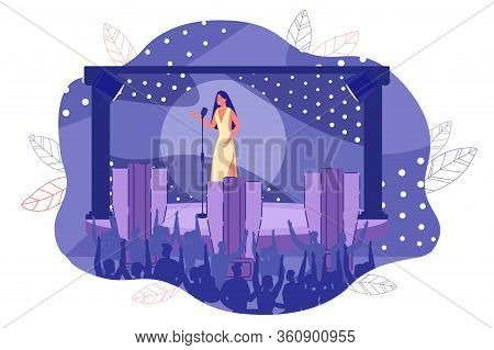 Young Woman Wearing Beautiful Elegant Dress Under Spotlight. Vocal Singer Performing On Stage. Girl