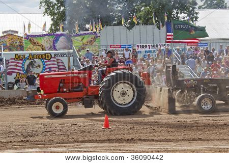 Red Allis Chalmers Tractor Going By