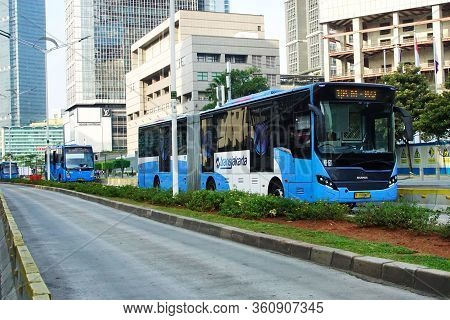 Jakarta, Indonesia  - June 6, 2019 ; Bus Rapid Transit (brt) Passes On Mh Thamrin Street In Central