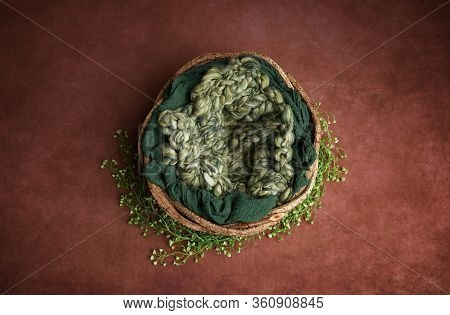Newborn Photography Digital Background Prop. Wicker Basket With Green Fur  On A Painted Canvas.